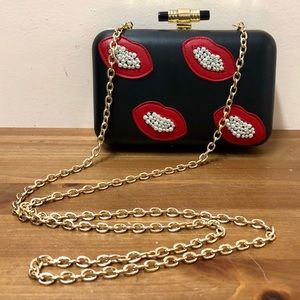 La Regale beaded lips faux leather chain bag